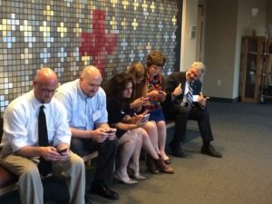 Social Advocates hard at work, ignoring Regional Red Cross CEO Phil Hansen